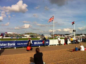 Watching show jumping in the main arena on a sunny evening